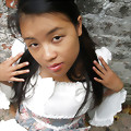 Addy is a cute Asian who loves posing in white lace