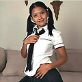 Kat Young in a school girl outfit